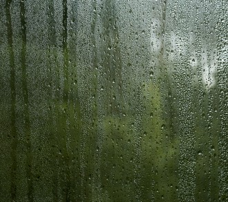 condensation droplets in a window glass, green nature abstract b