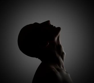 Creepy profile of the mysterious man. Low-key lighting